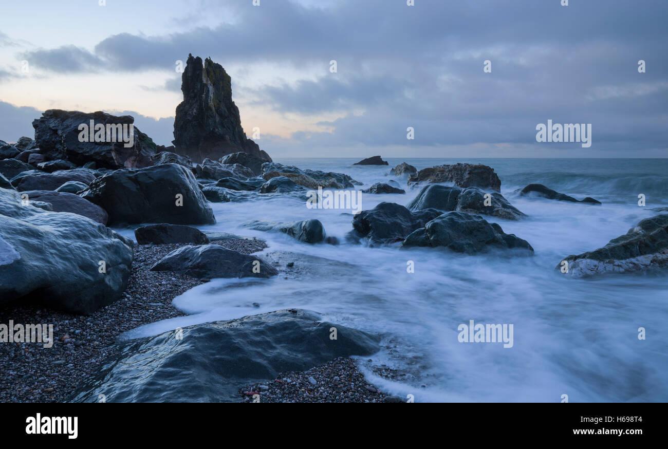 Tidal surge at Shag Rock near Downderry Cornwall - Stock Image