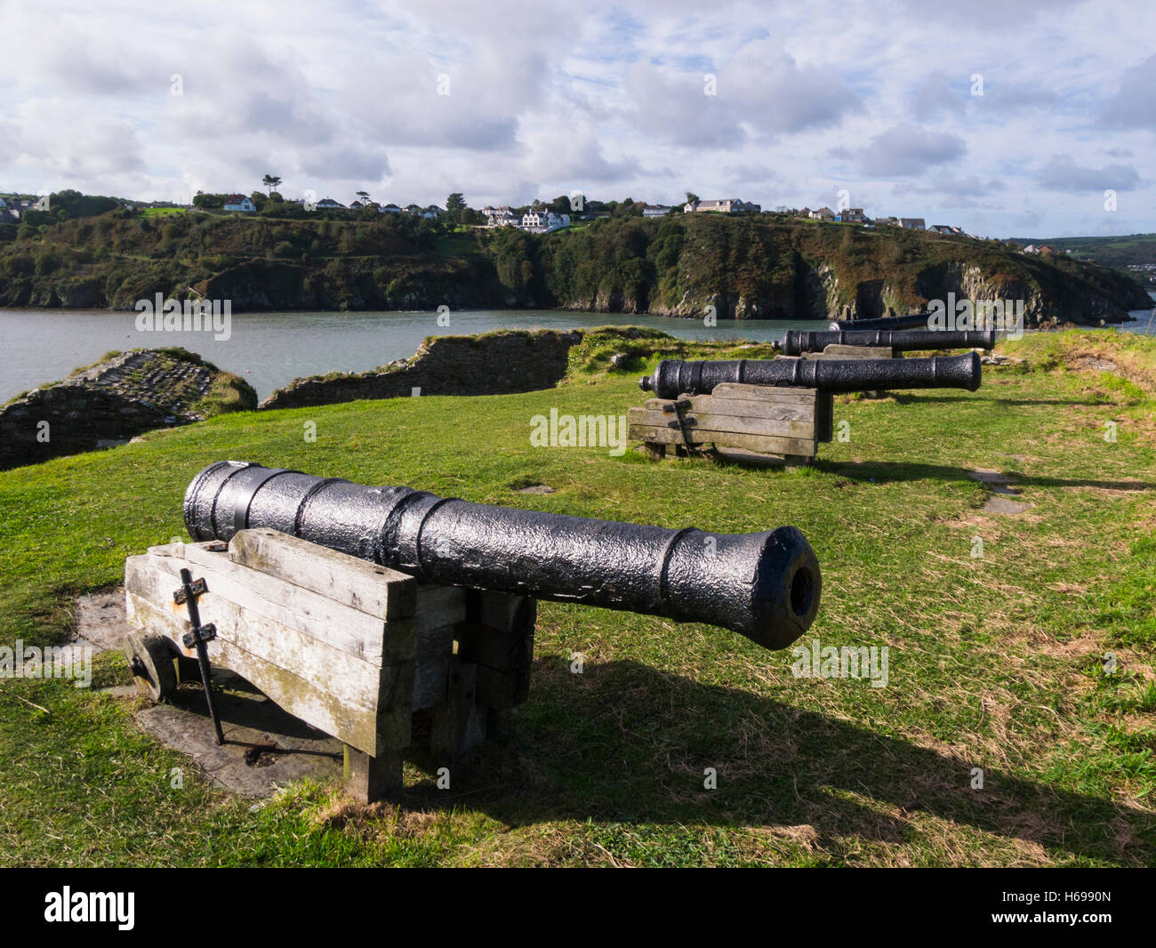 Four 9 pounder guns in the ruins of Fishguard Fort built 1781 to guard prosperous port  Pembrokeshire South Wales - Stock Image