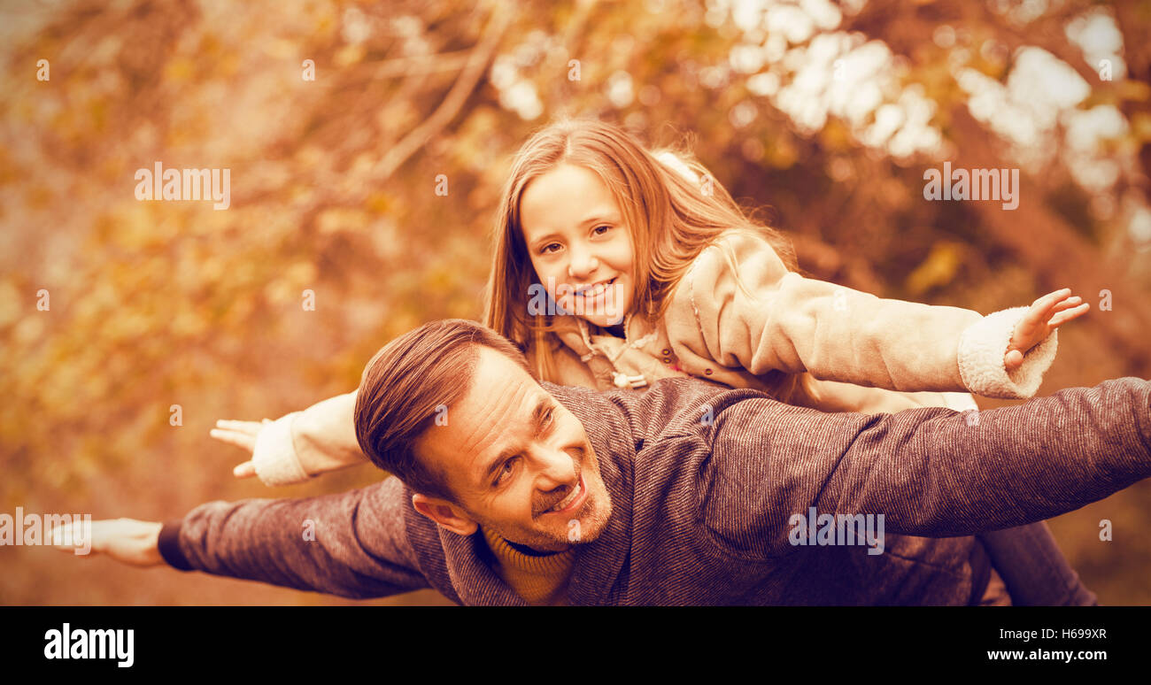 Father and his daughter imitatimg plane - Stock Image