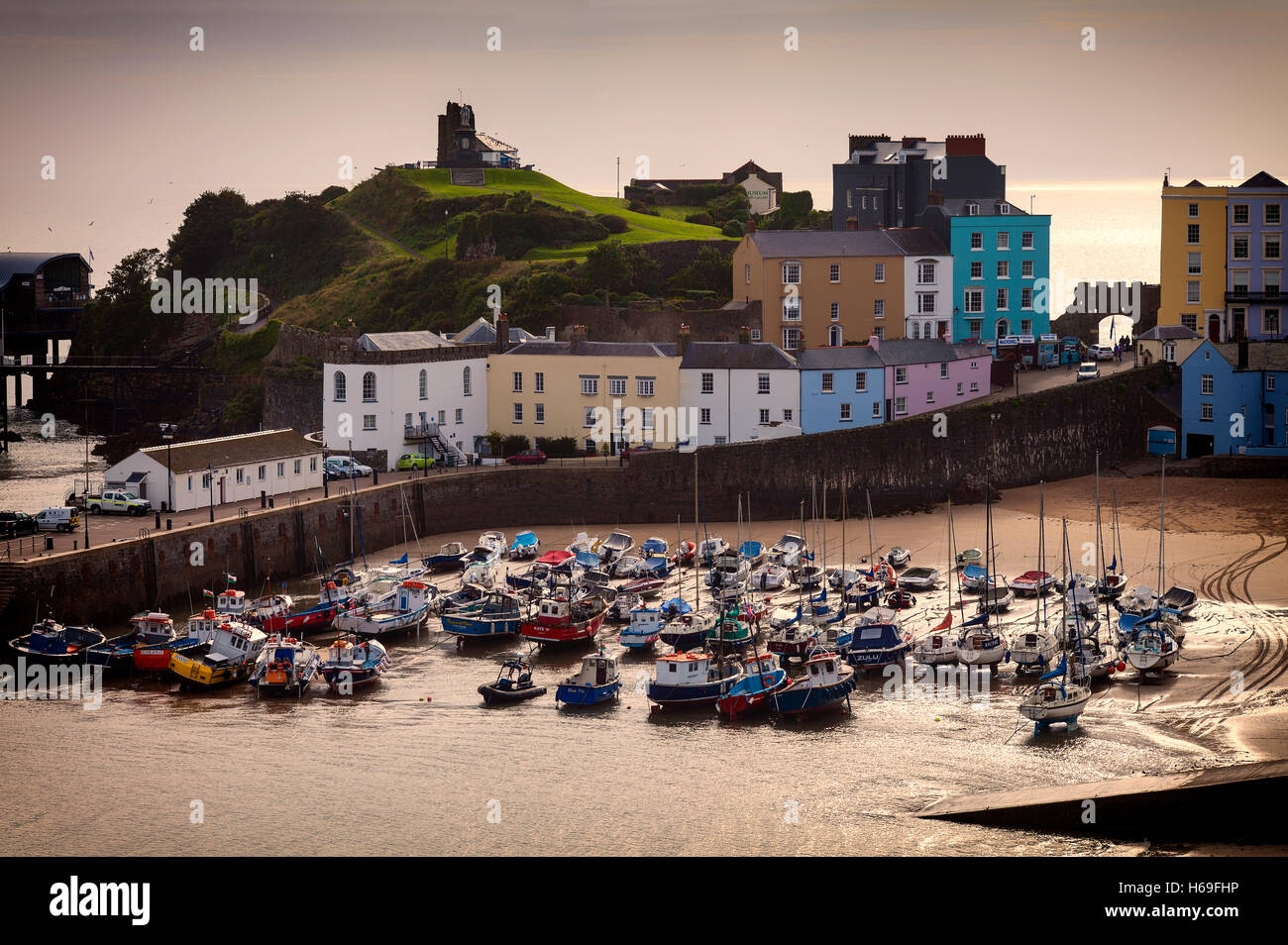 The Harbour and Castle Hill in Tenby a seaside town on the western side of Carmarthen Bay, Pembrokeshire, West Wales, - Stock Image