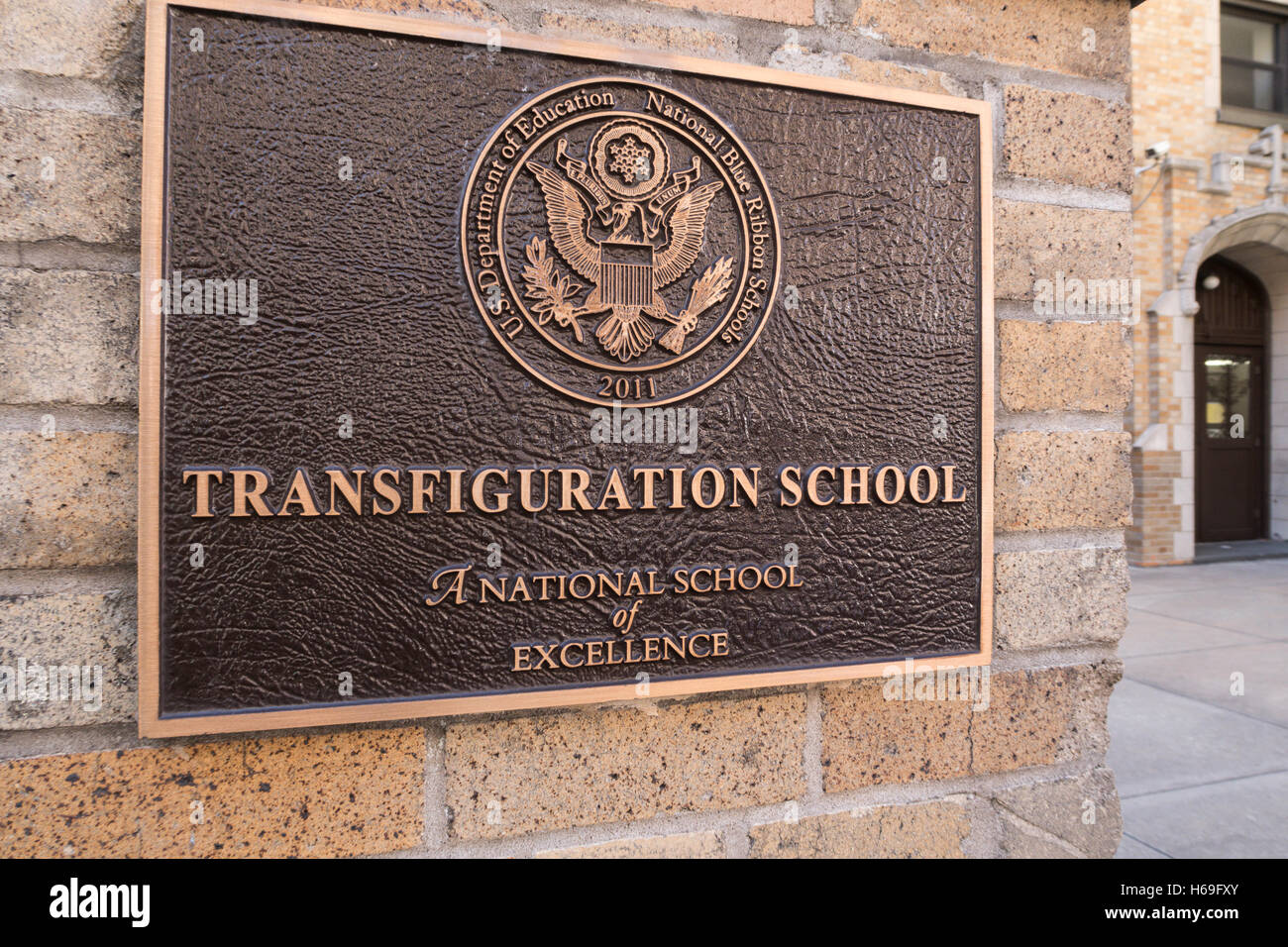 Bronze Plaque,  A National School of Excellence,  Transfiguration  School, Chinatown, NYc, USA - Stock Image