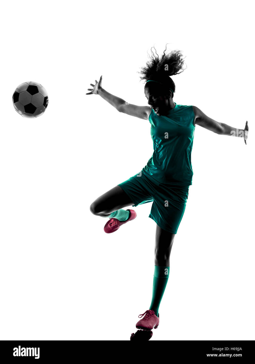 one teenager girl child  playing soccer player in silhouette isolated on white background - Stock Image