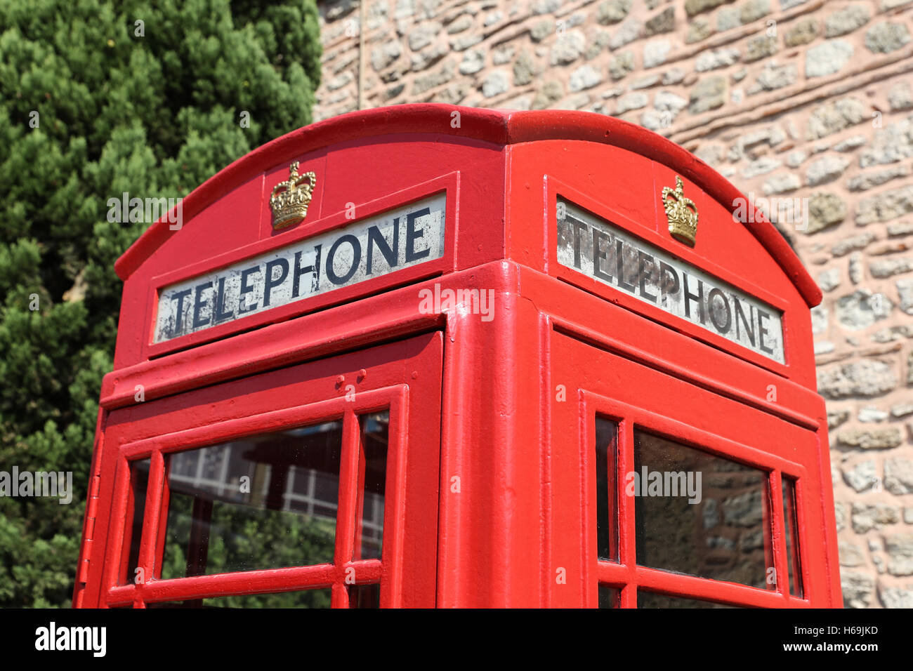 The red telephone box, a telephone kiosk for a public telephone - Stock Image