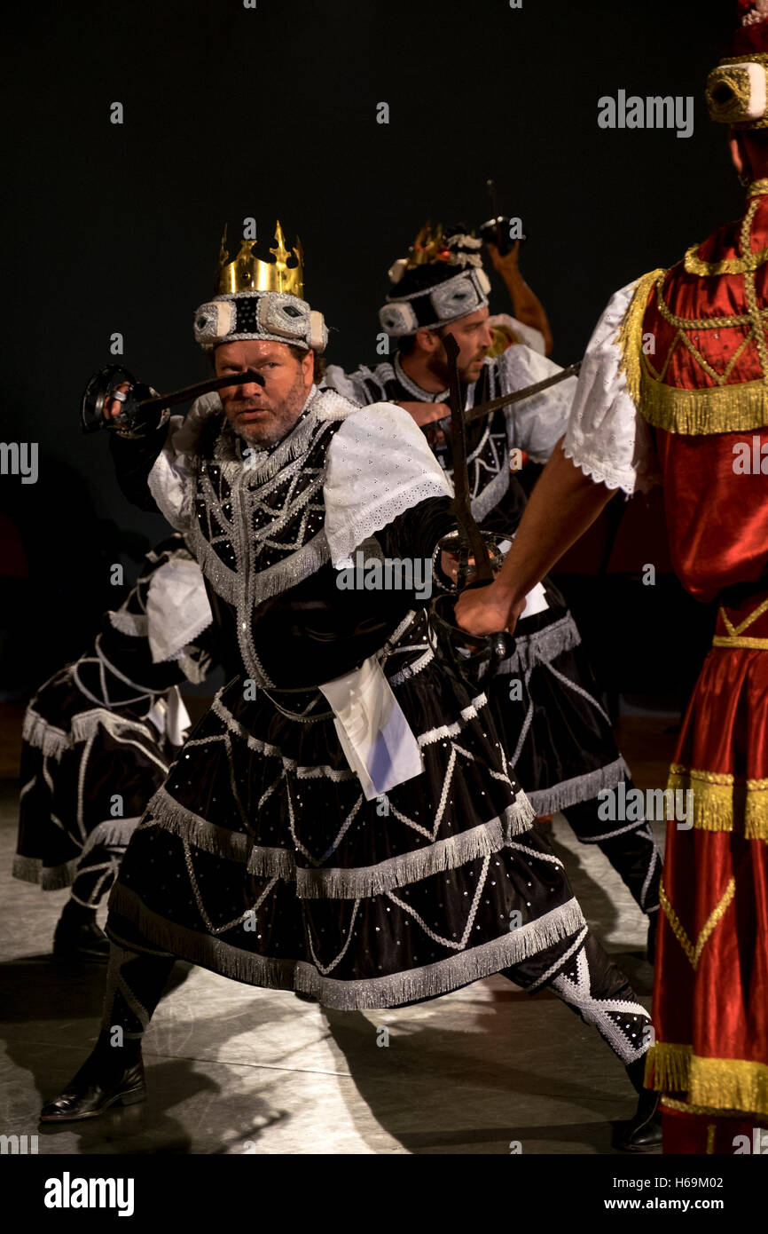 A performance of a traditional 'moreska' sword dance and drama in the town of Korcula in Croatia. - Stock Image