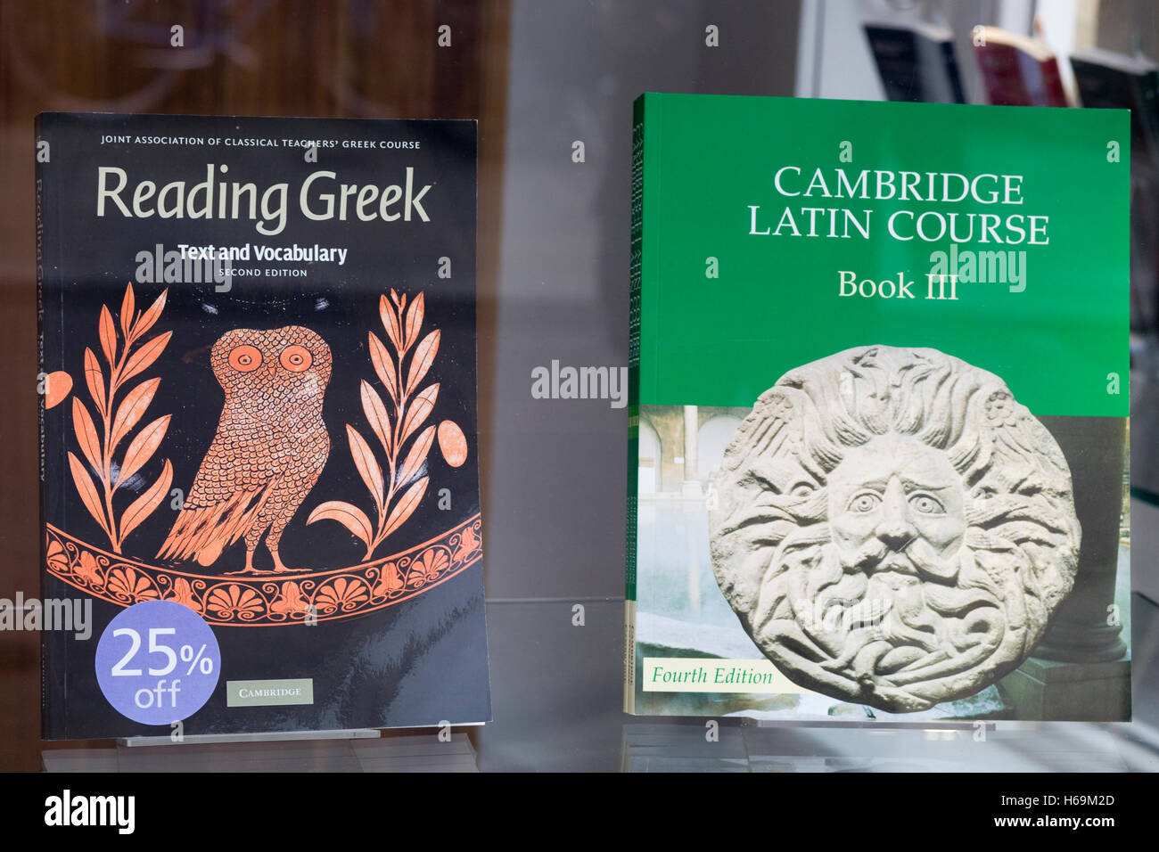 """Education books in a shop window """"Cambridge Latin Course Book 3 Student's Book"""" and """"Reading Greek"""" Stock Photo"""