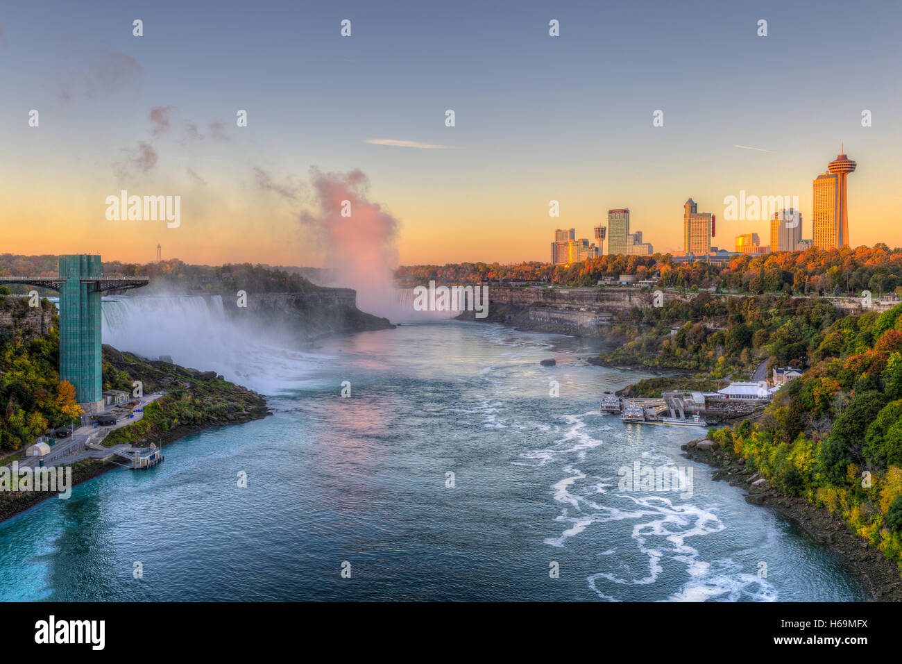 The Niagara River including the American Falls, Horseshoe Falls, and skyline of Niagara Falls, Ontario just after - Stock Image