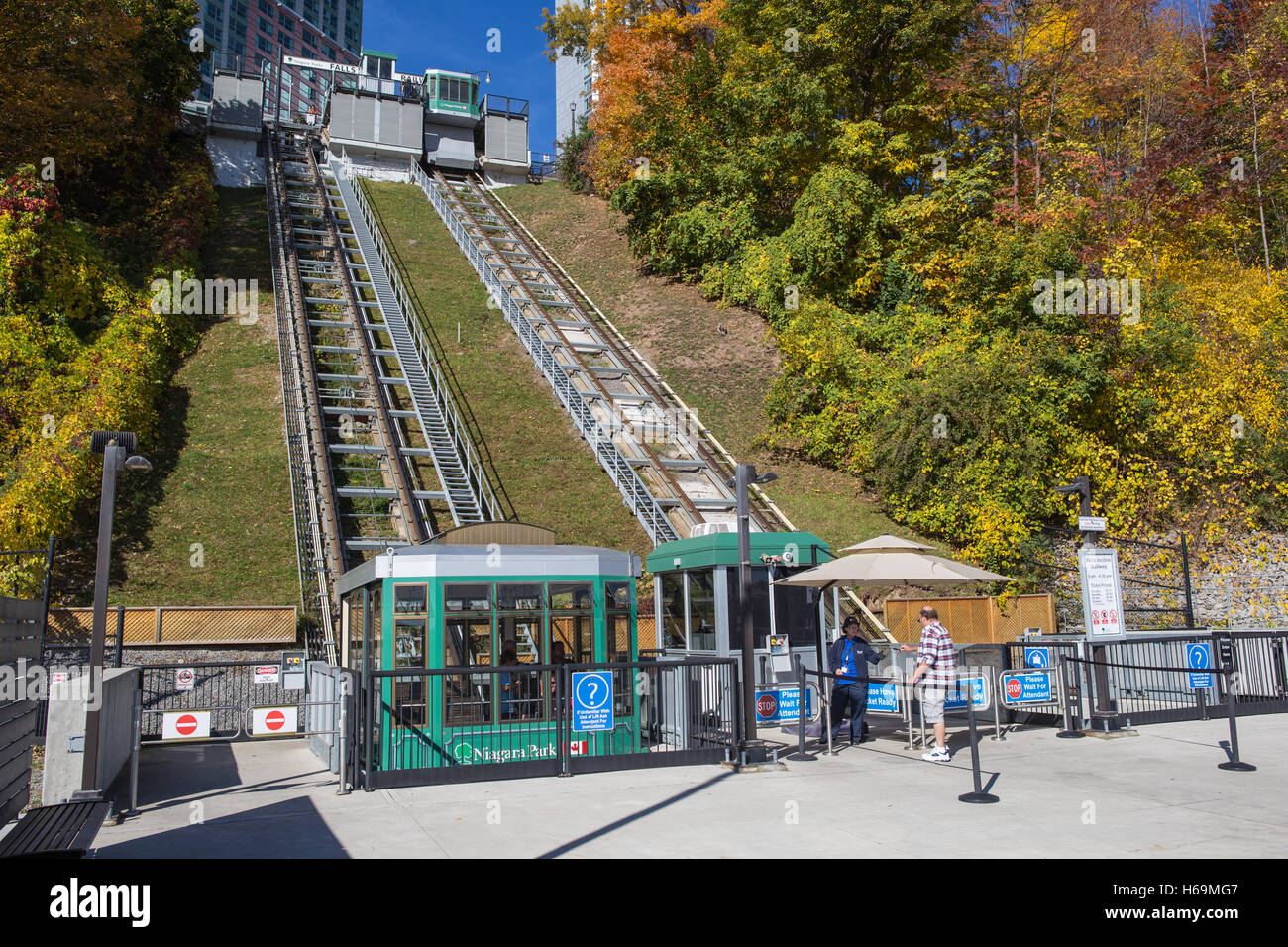 A passenger presents his ticket to board the Falls Incline Railway at Falls Incline Plaza in Niagara Falls, Ontario, - Stock Image