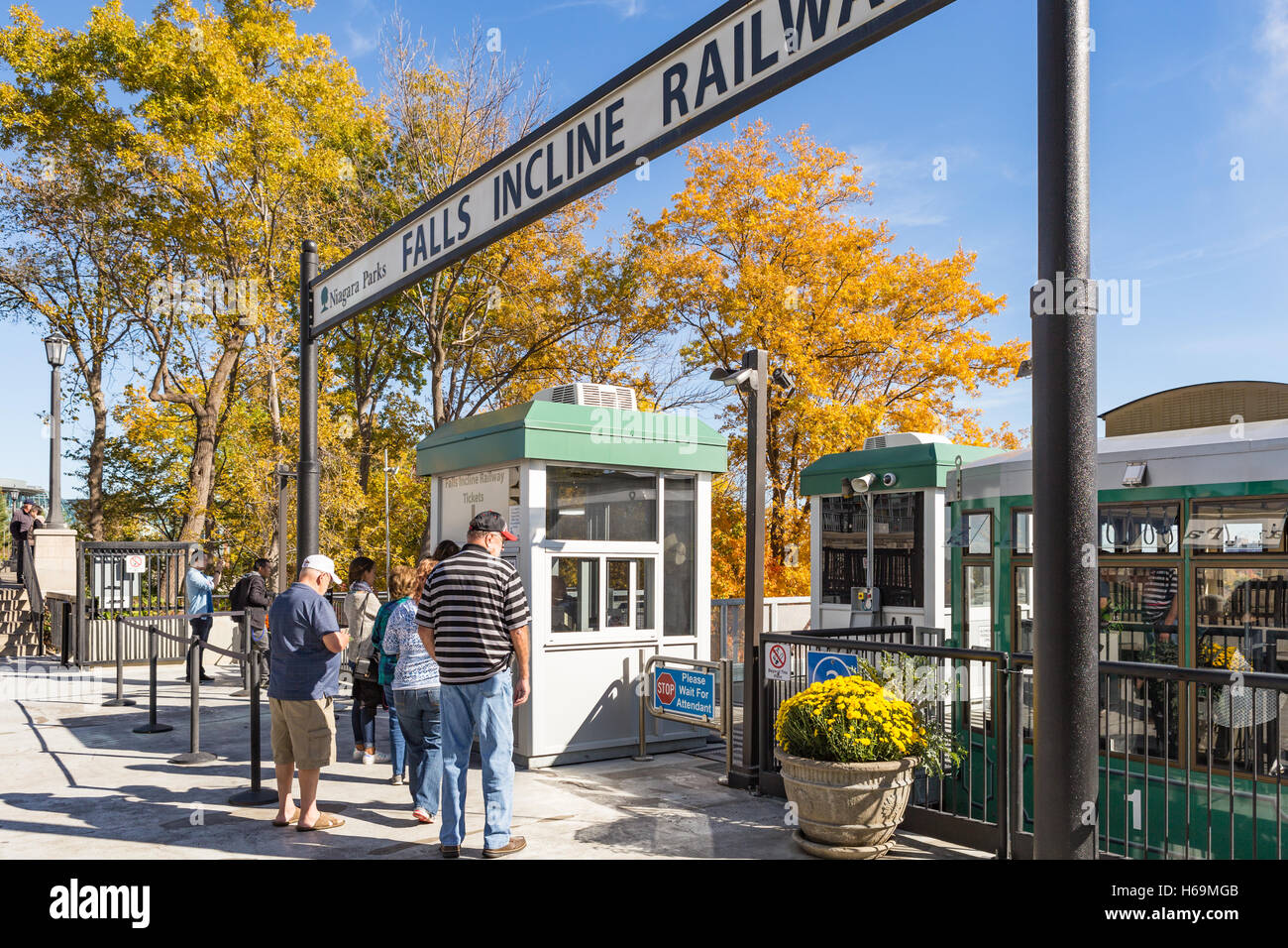 Passengers purchase tickets for the Falls Incline Railway in Niagara Falls, Ontario, Canada. - Stock Image