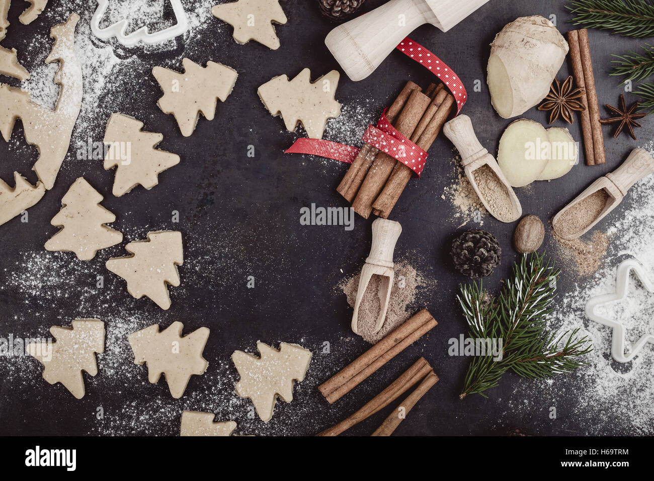 Frame of baking ingredients and tolls for gingerbread dough preparation. Christmas cookies and spices over rustic - Stock Image