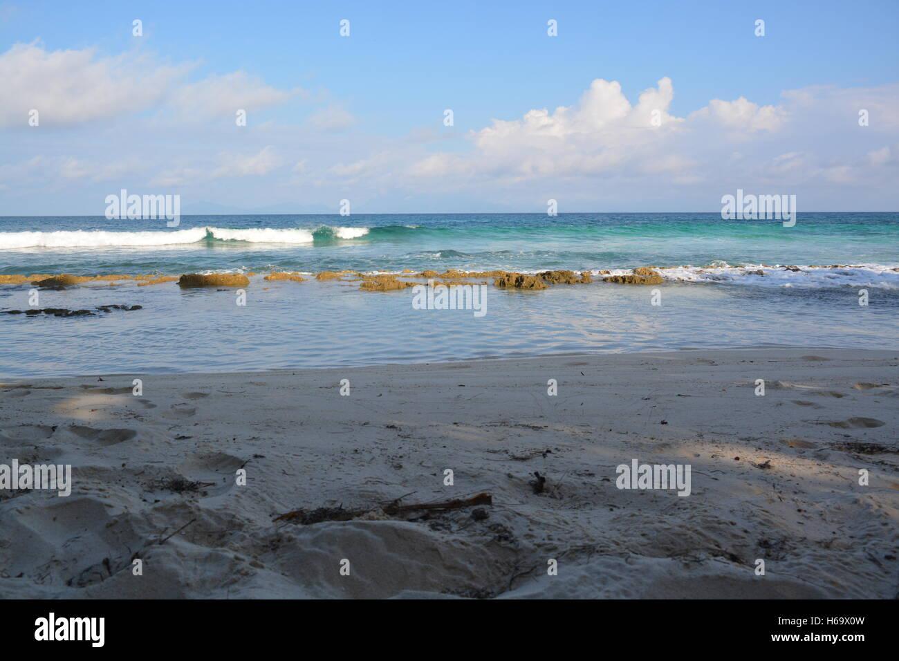 Seychelles blue ocean waves clear sky sand Stock Photo
