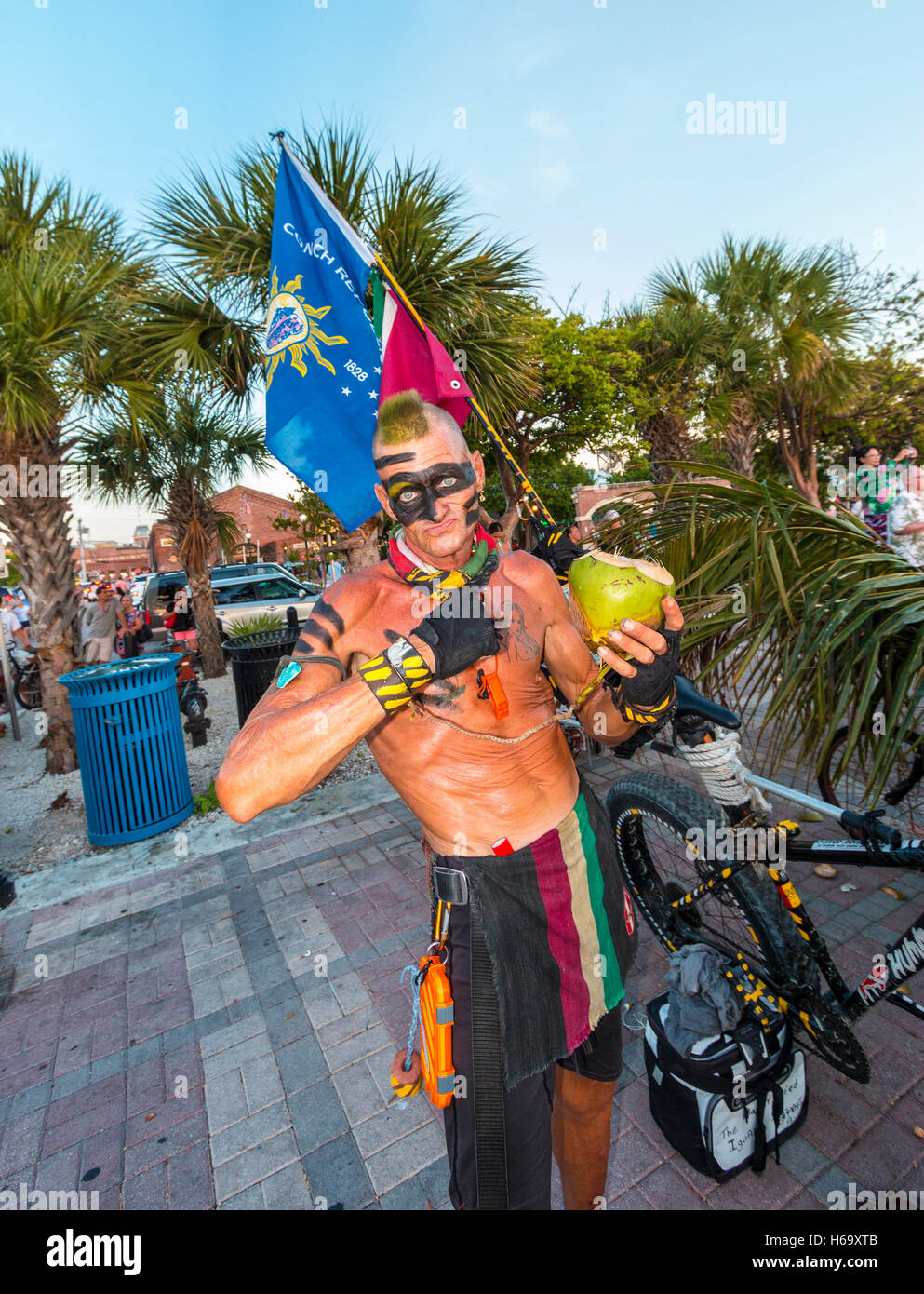 Crazy, joyous sunset scene nightly at Mallory Square in Key West. Here, a drummer performs. - Stock Image
