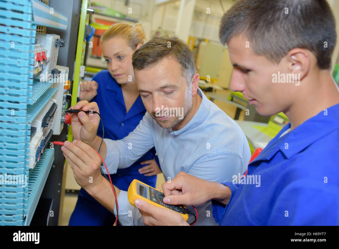Student electricians using a multi metre Stock Photo