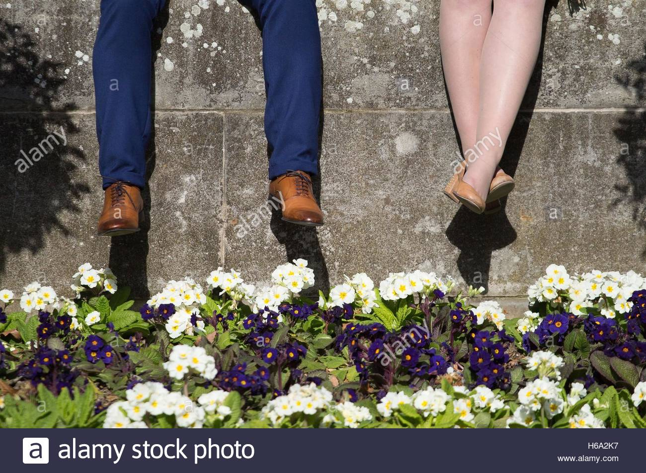 File photo dated 06/03/15 of a man and a woman in Festival Gardens in London, as the UK is placed below countries - Stock Image