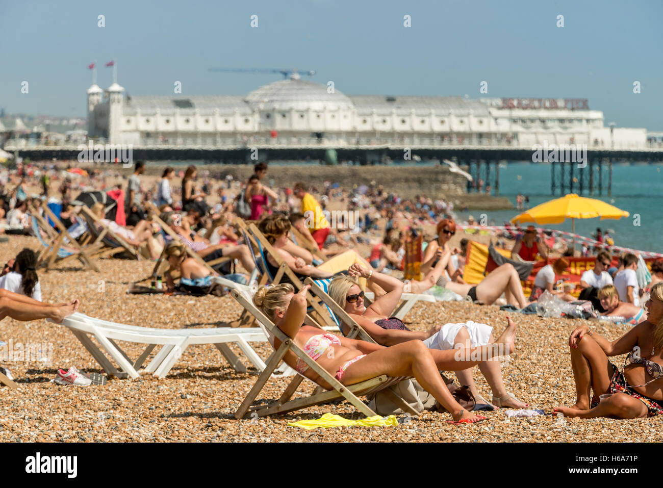 A sunny July day on Brighton beach - Stock Image