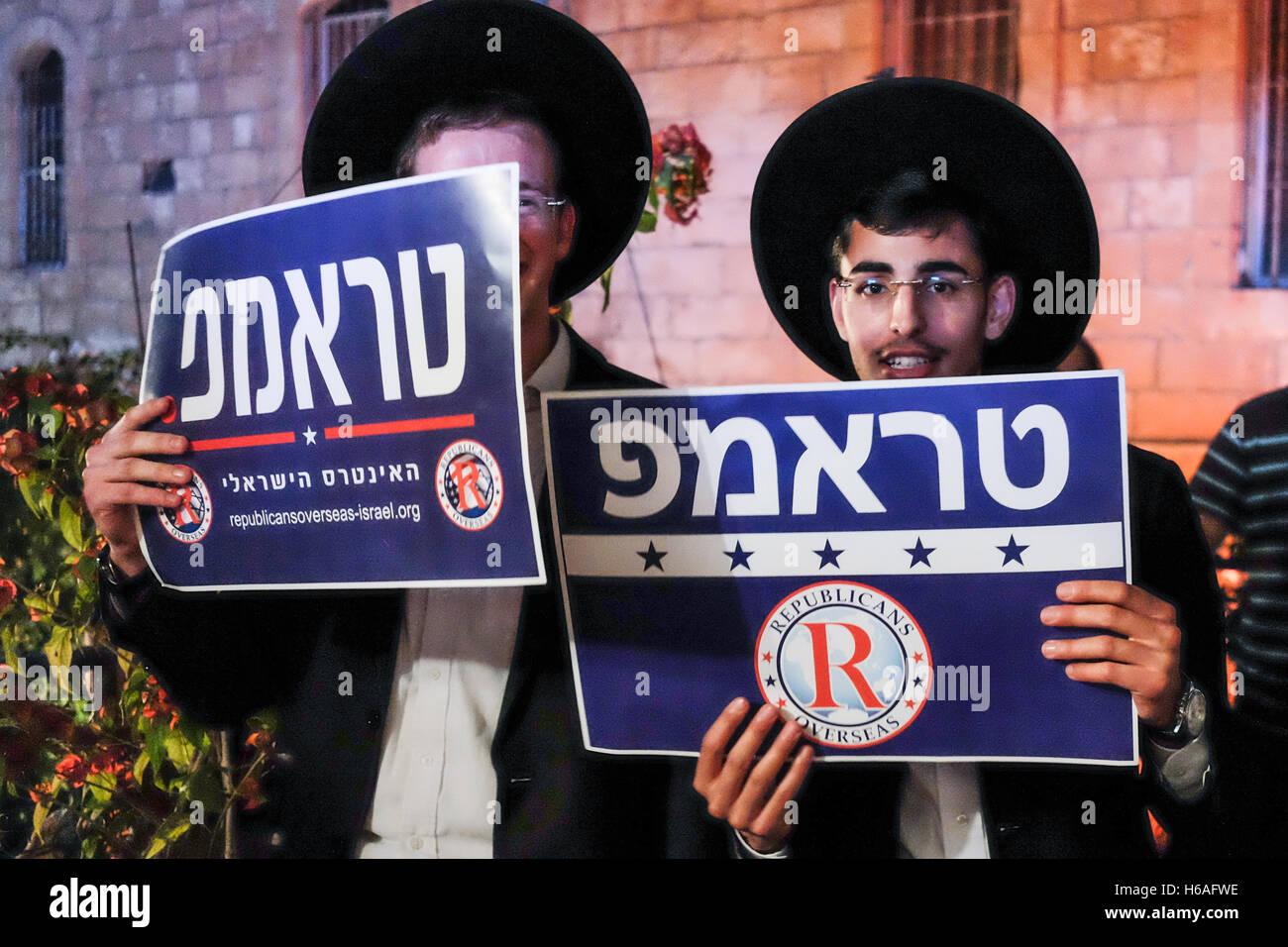 Jerusalem, Israel. 26th October, 2016. Two Orthodox Jewish men hold up pro-Trump signs in Hebrew as Republicans - Stock Image