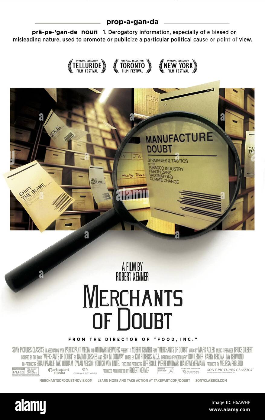MAGNIFYING GLASS POSTER MERCHANTS OF DOUBT (2014) - Stock Image
