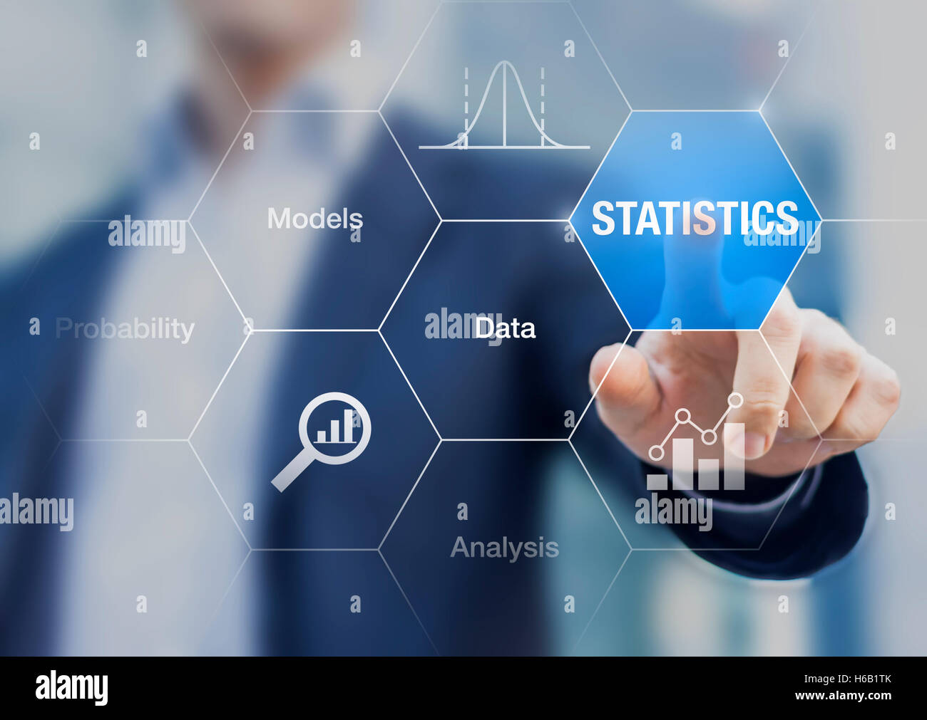 Concept about statistics, data, models and analysis on a transparent screen with a businessman in background - Stock Image