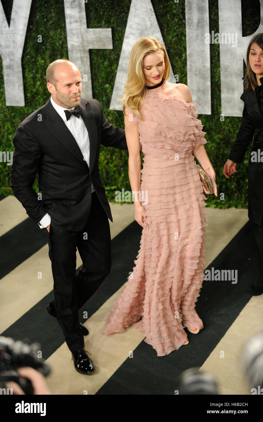 Actor Jason Statham and Rosie Huntington-Whiteley arrive for the 2013 Vanity Fair Oscar Party on February 24, 2013 Stock Photo