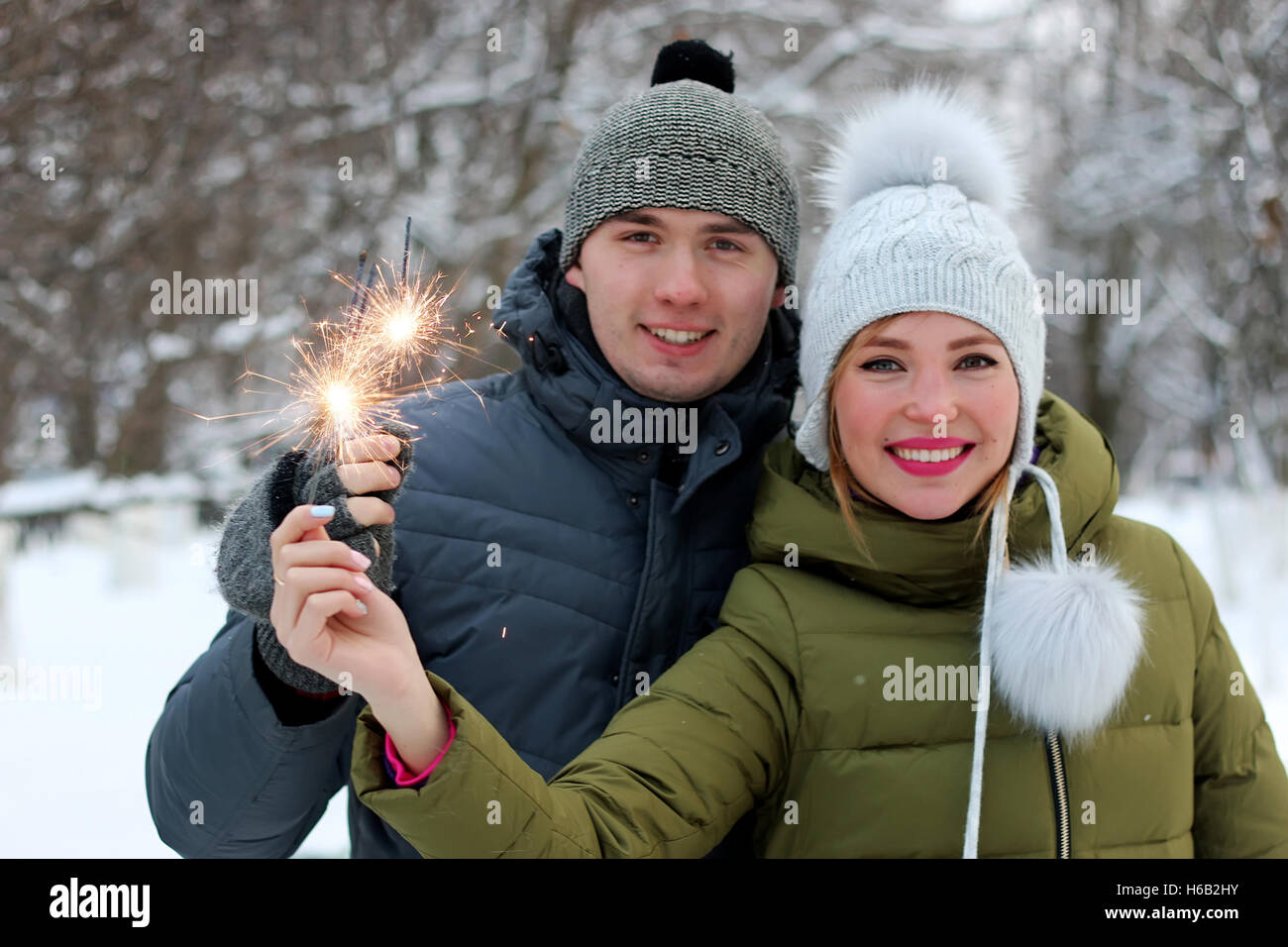 couple with sparklers on the street Stock Photo
