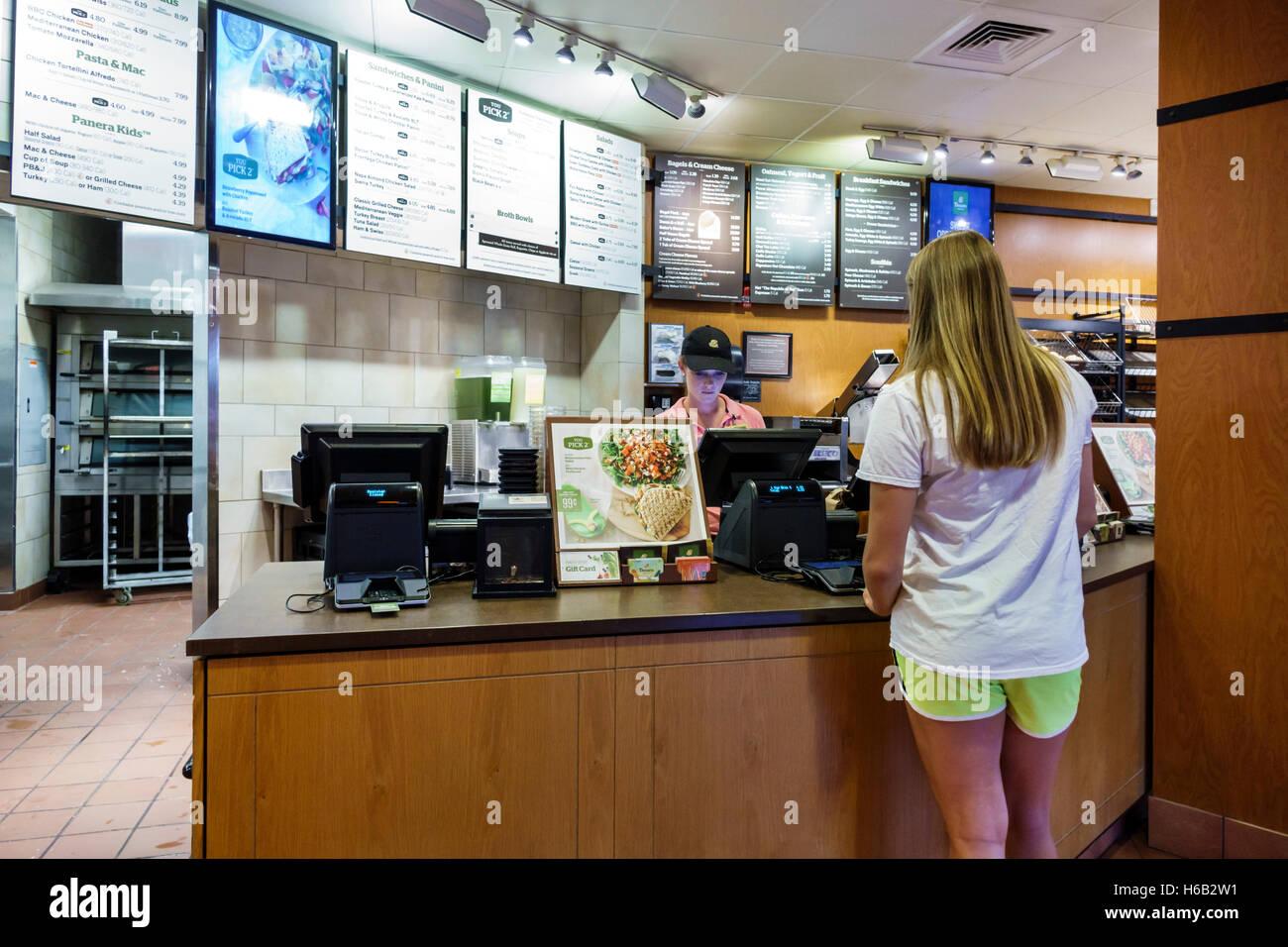 port st lucie florida saint panera bread inside restaurant counter customer employee cashier woman job