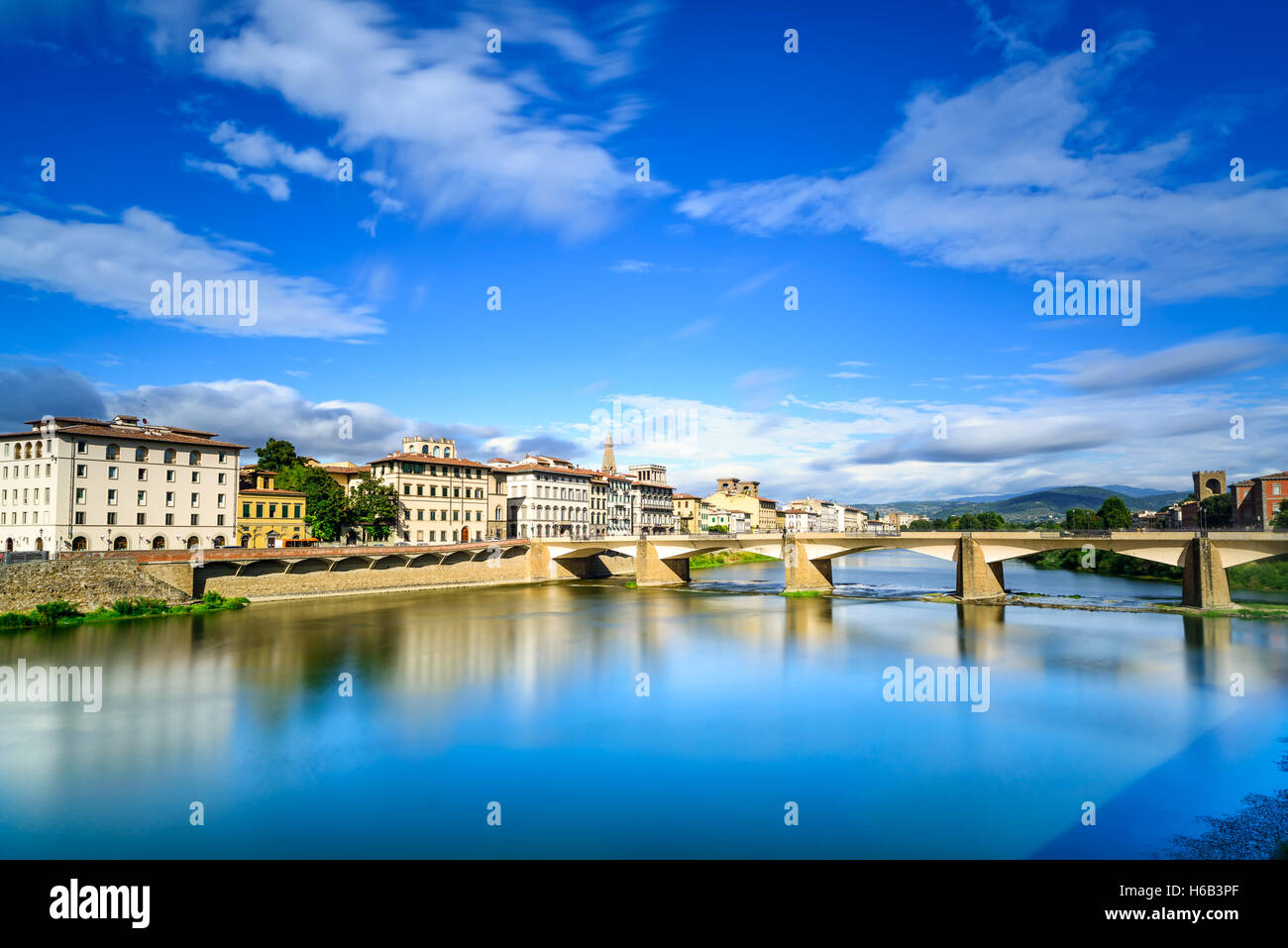 Florence or Firenze, Ponte alle Grazie bridge landmark on Arno river, sunset landscape with reflection. Tuscany, - Stock Image