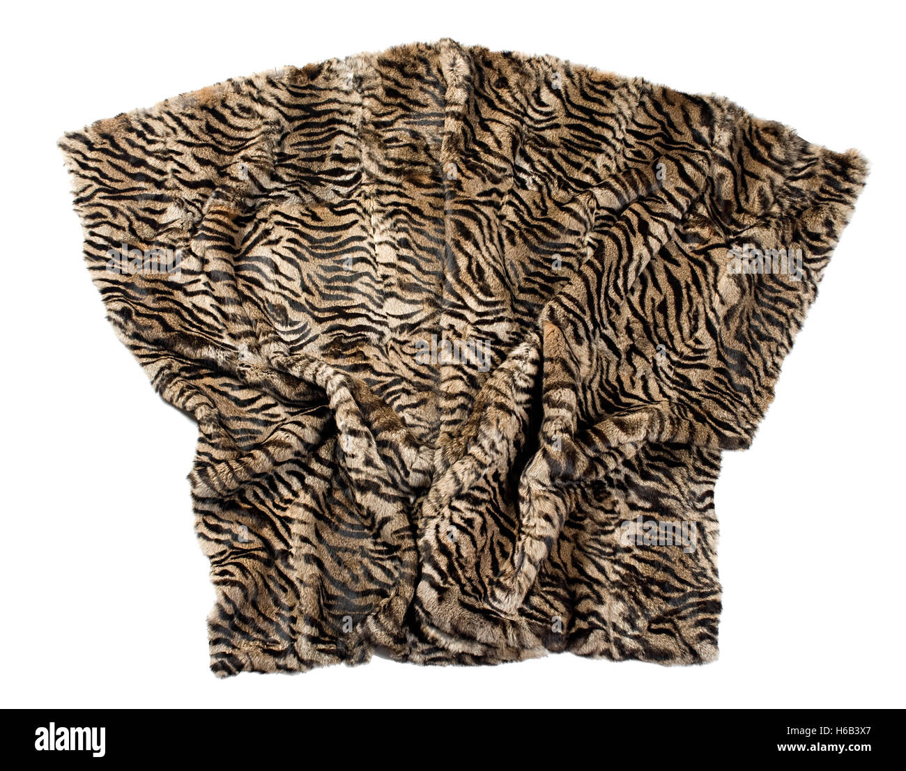 Leopard pattern blanket isolated on white artistically displayed with soft folds gathered at the bottom - Stock Image