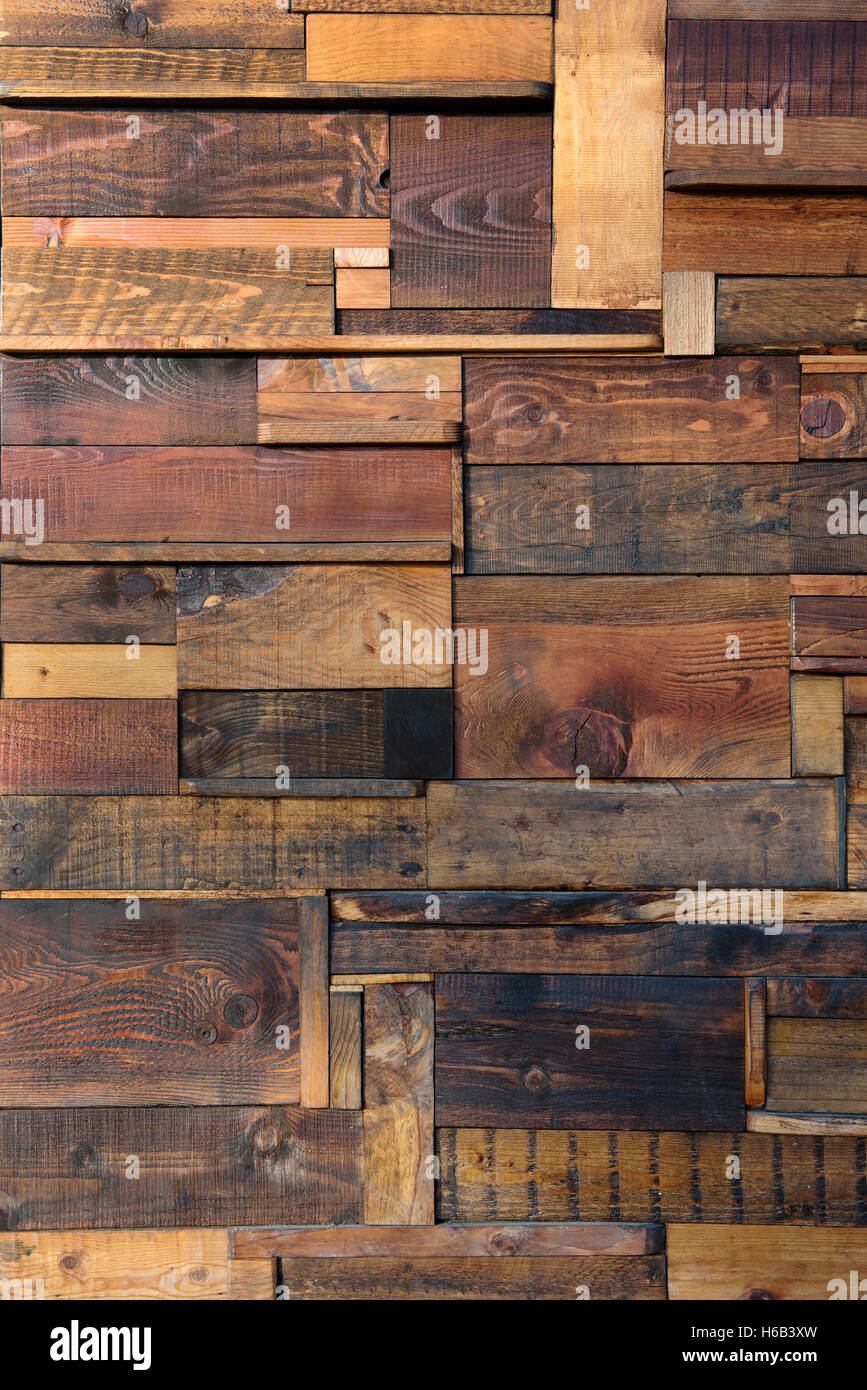 Abstract wooden plank background with randomly arranged short lengths of old weathered wood in a full frame view - Stock Image