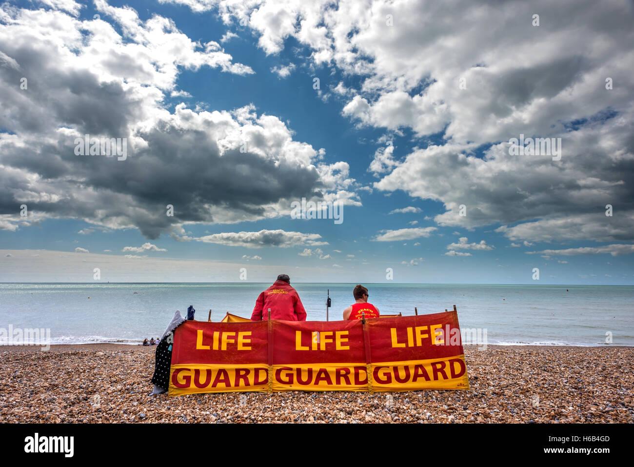 Lifeguards on Brighton beach - Stock Image