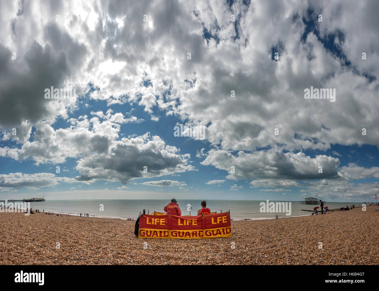 Lifeguards on Brighton beach NB THIS IS A PHOTOMERGE OF SEVERAL FRAMES - Stock Image