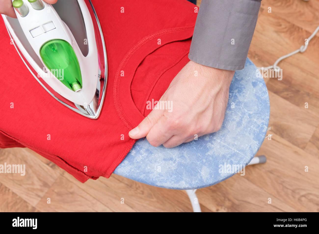 Man ironing hands close up - Stock Image
