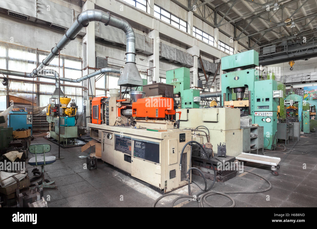 Machine-building plant. Shop with machines for production of plastic parts. Injection molding thermoplastic machine - Stock Image
