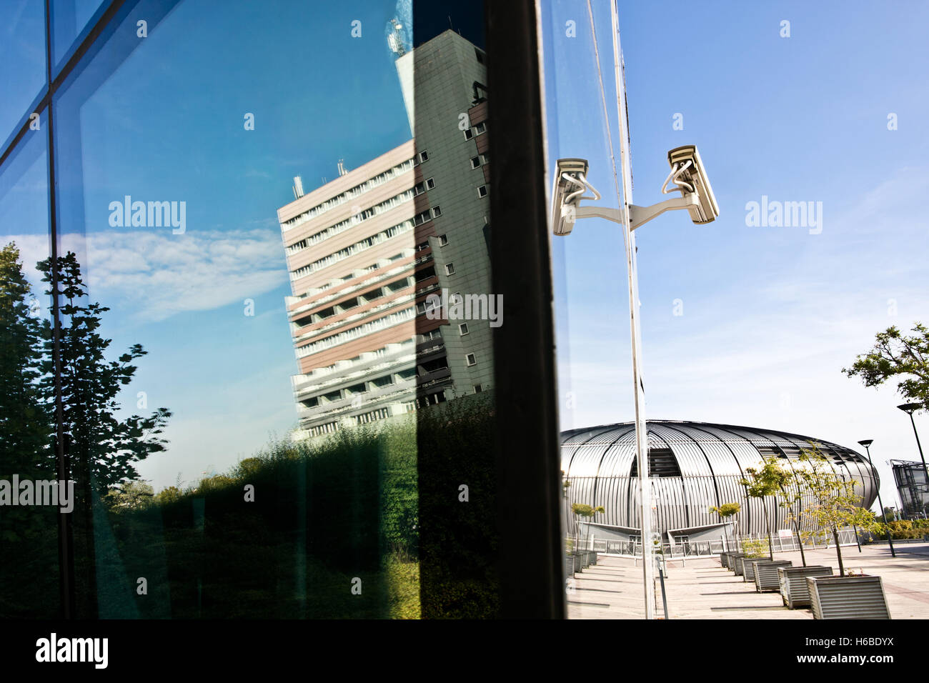 Reflection of modern building with surveillance cameras - Stock Image