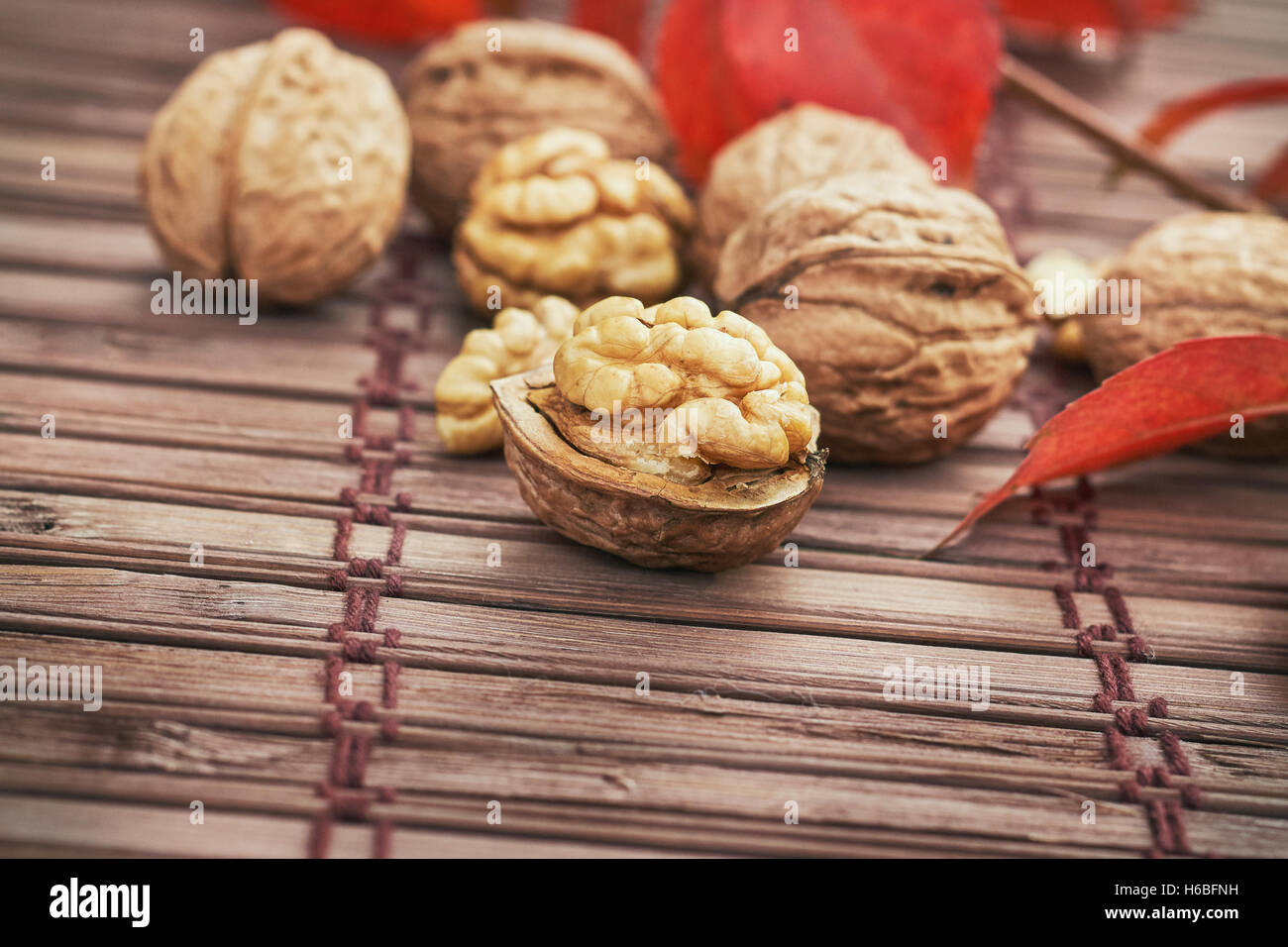 Walnuts on wooden background with copy space - Stock Image