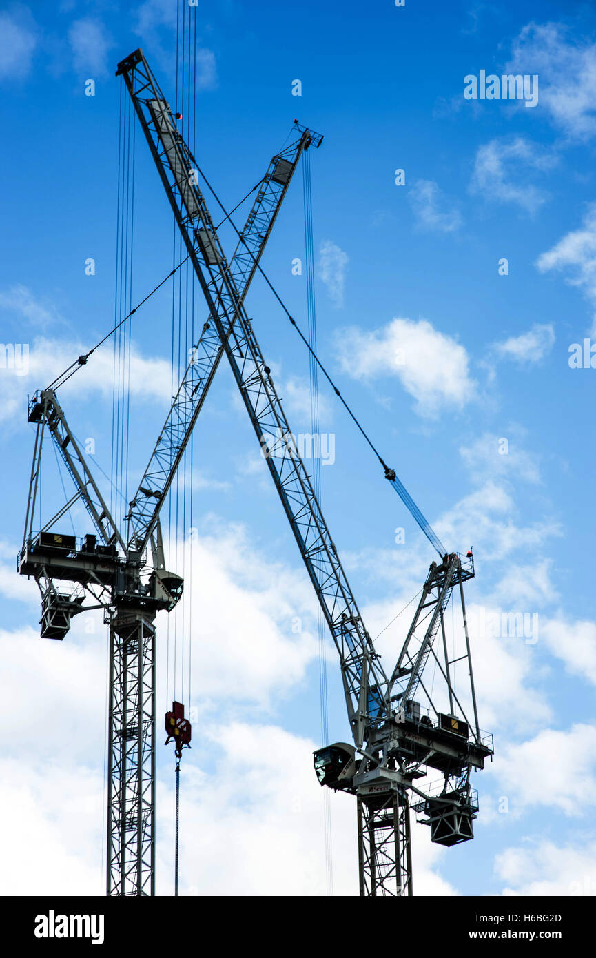 Two Tower Cranes in London Against a Blue Cloudy Sky - Stock Image