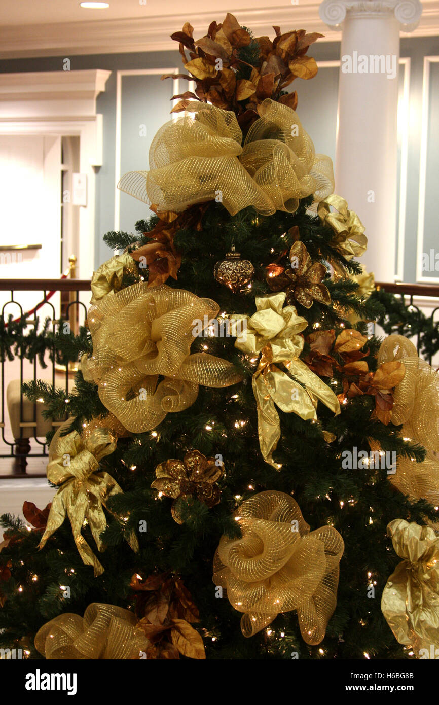 large christmas tree top and yellow fabric decorations stock image - Large Christmas Tree Decorations