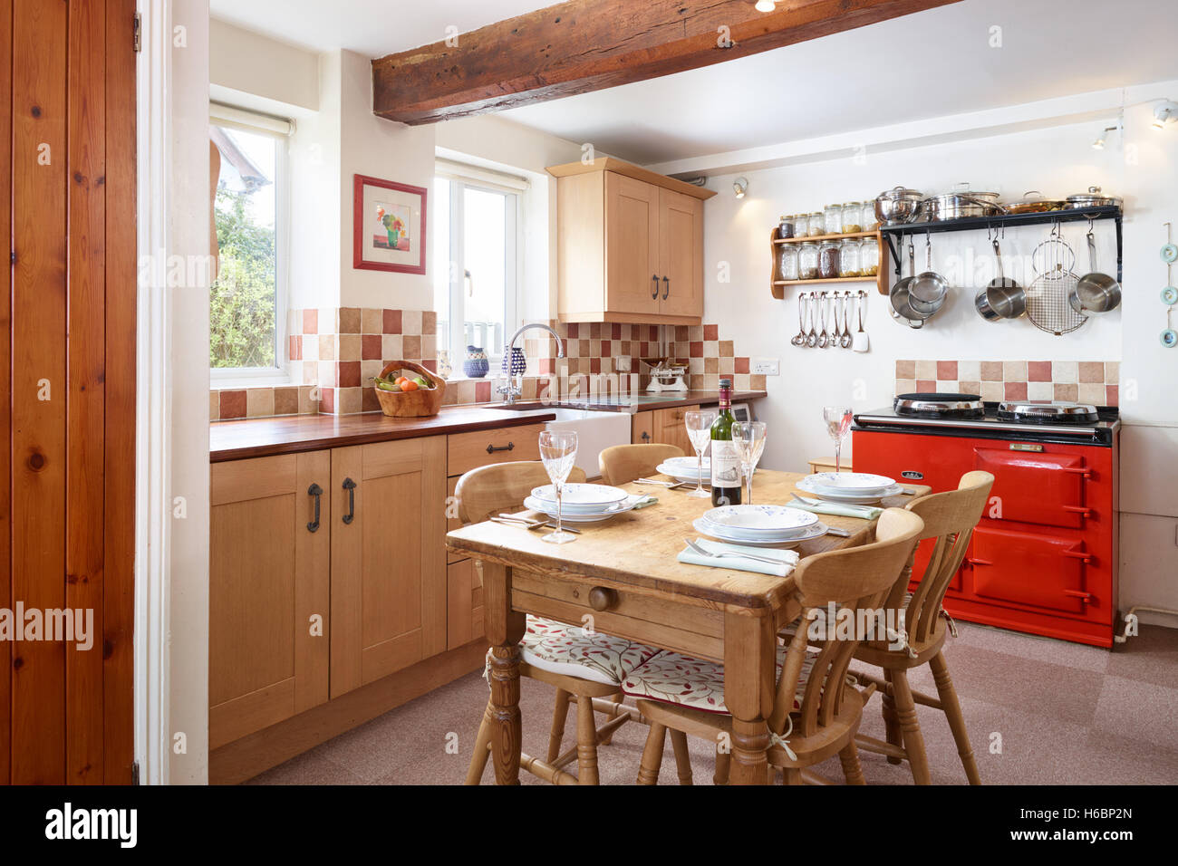 A Traditional Fresh Country Kitchen Showing A Red Aga Table Units