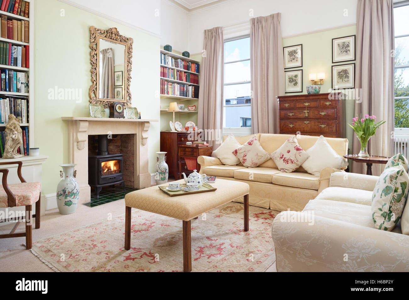 The living room in a period Georgian apartment showing antique furniture & paintings. Gloucestershire, UK - Stock Image