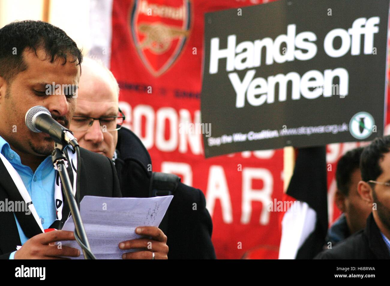 A man speaks in solidarity with the people of Yemen outside of the Saudi Arabian embassy in London, as thousands - Stock Image