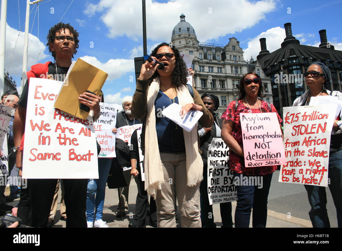 Female campaigners protest on Parliament Square for the immediate closure of Yarls Wood Immigration Removal Centre - Stock Image