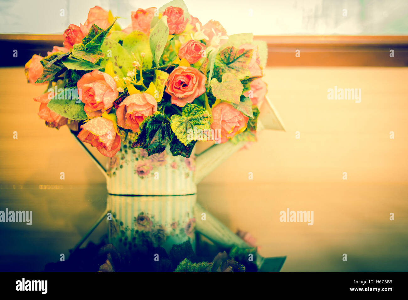 Beautiful flowers in vase on blue background.Vintage style. - Stock Image