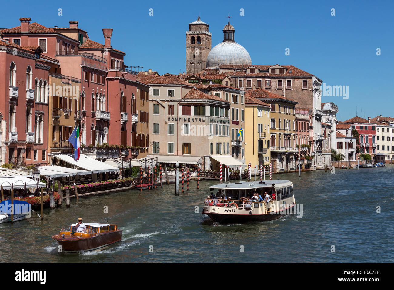 A Vaporetto (public water bus) on the Grand Canal in Venice in northern Italy. - Stock Image