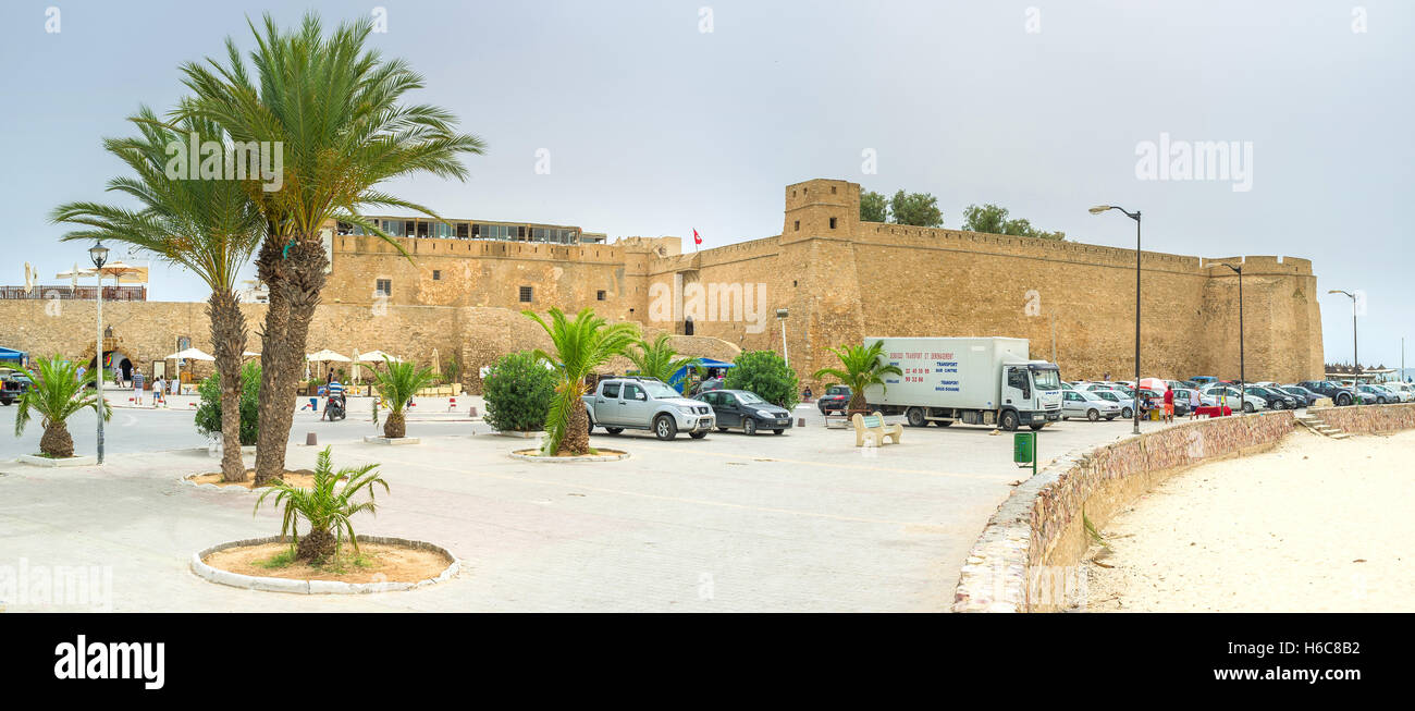 The modern promenade with the view on high walls of Medina - Stock Image