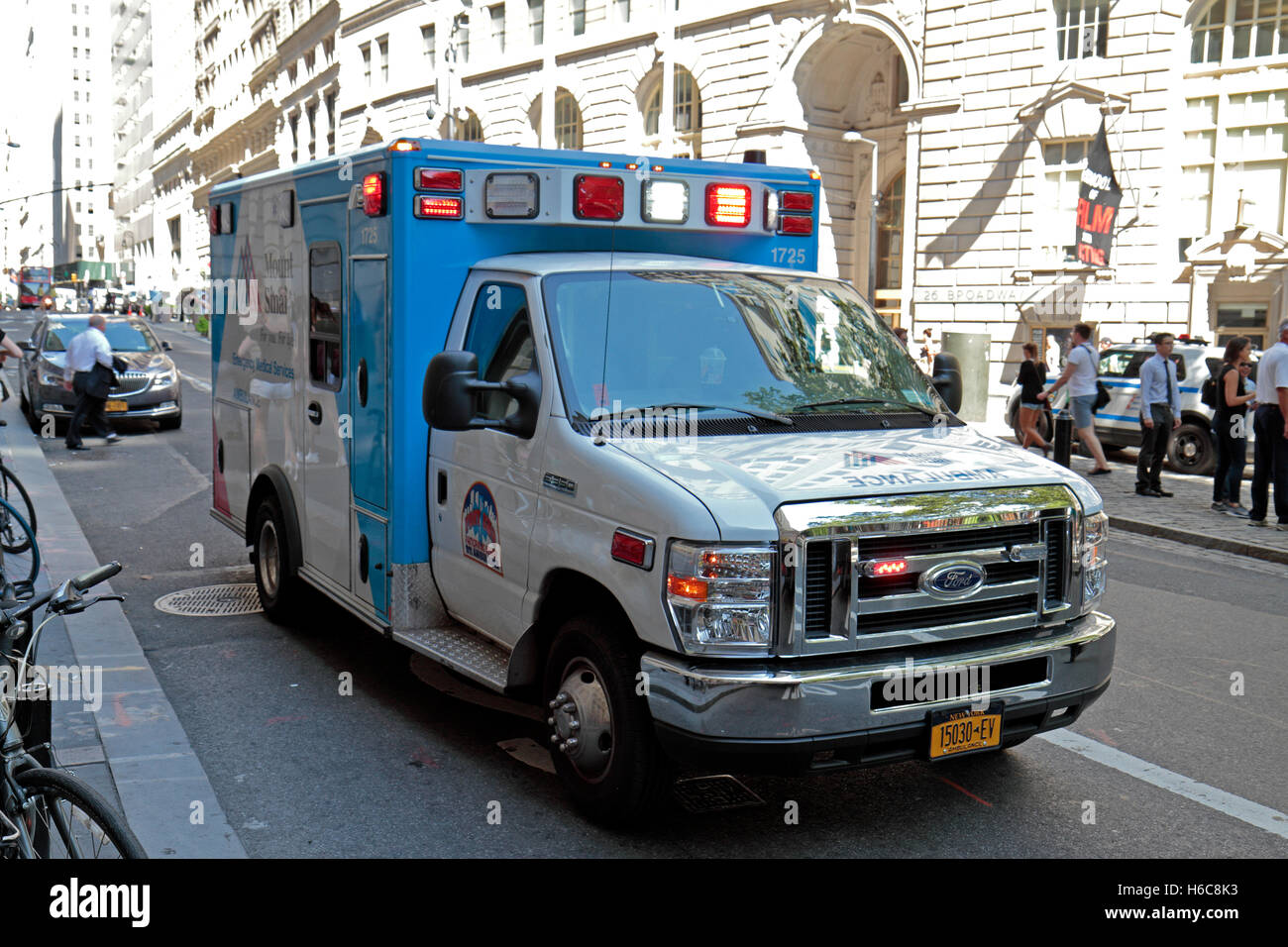 A Mount Sinai ambulance on an emergency call (lights flashing) in Manhattan, New York, United States. - Stock Image
