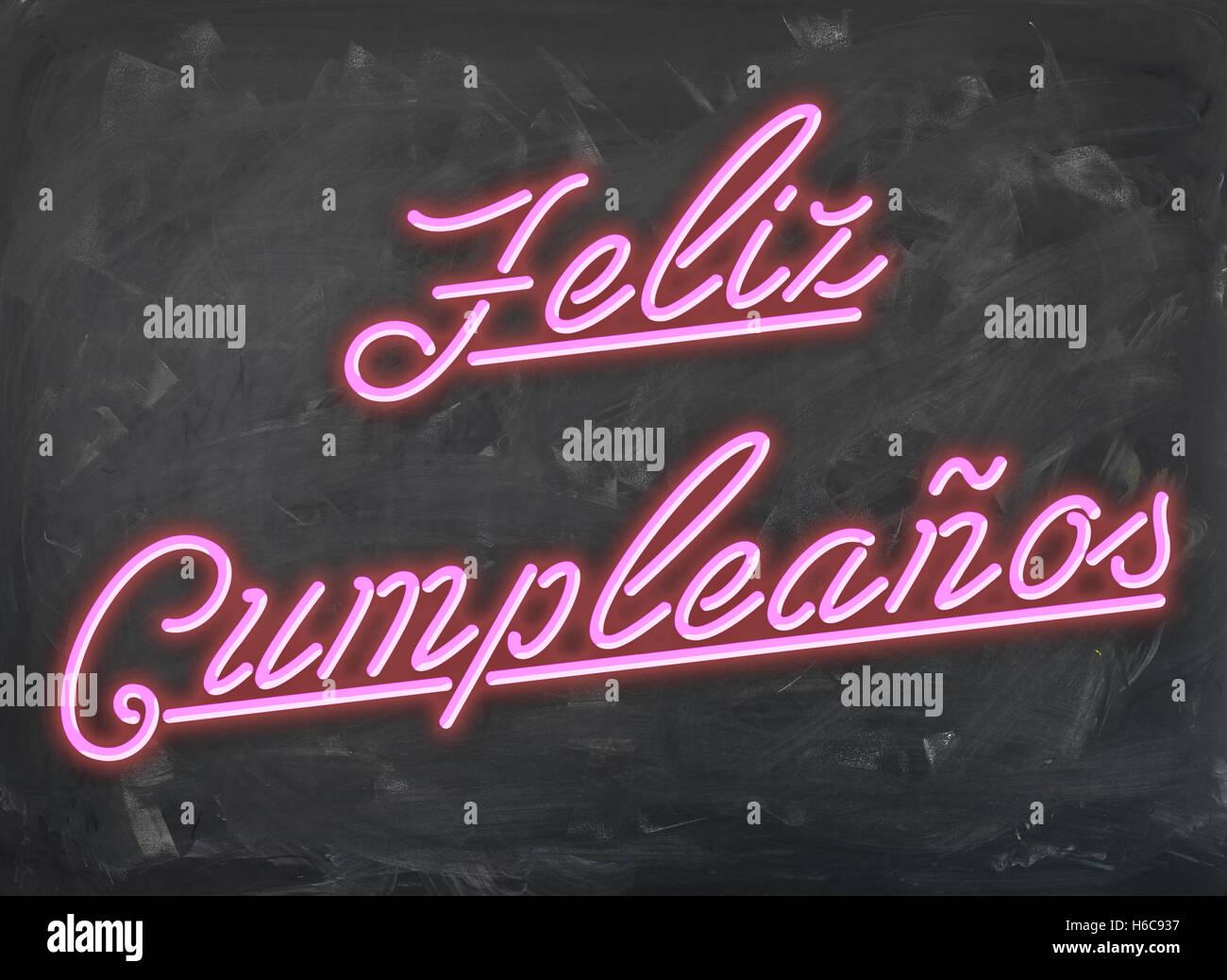feliz cumpleanos pink neon font on handwiped dark chalk board