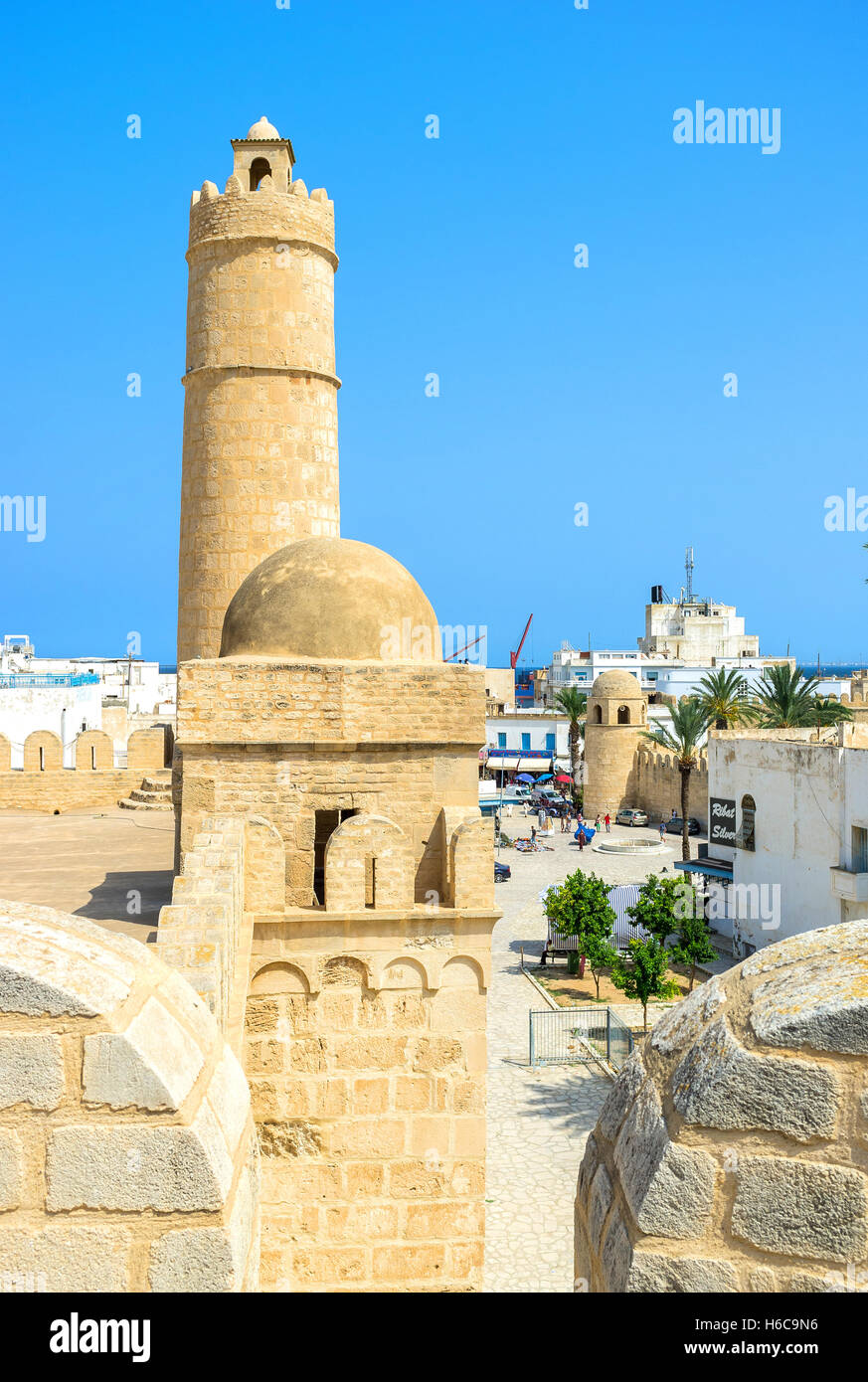 The ramparts of the Ribat citadel is the nice viewpoint that overlooks the old town, port and the stone tower - Stock Image