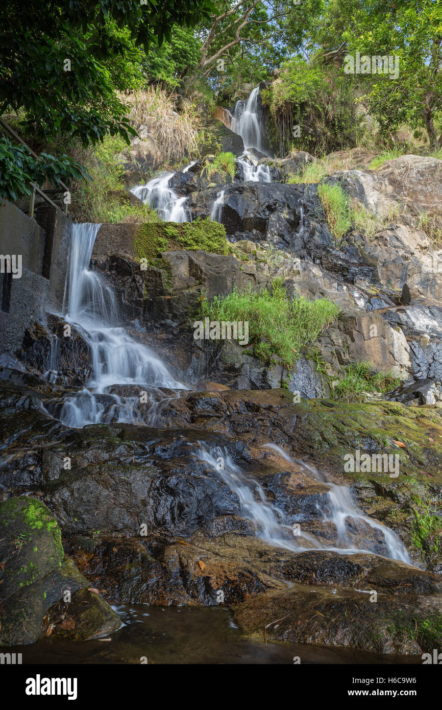 Low water flow at the lower fall of the Silvermine Waterfalls on the Lantau Island in Hong Kong, China. - Stock Image