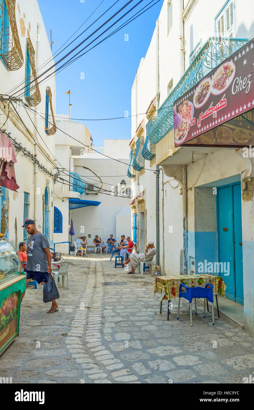 The narrow shady street is the best place for the teahouse - Stock Image