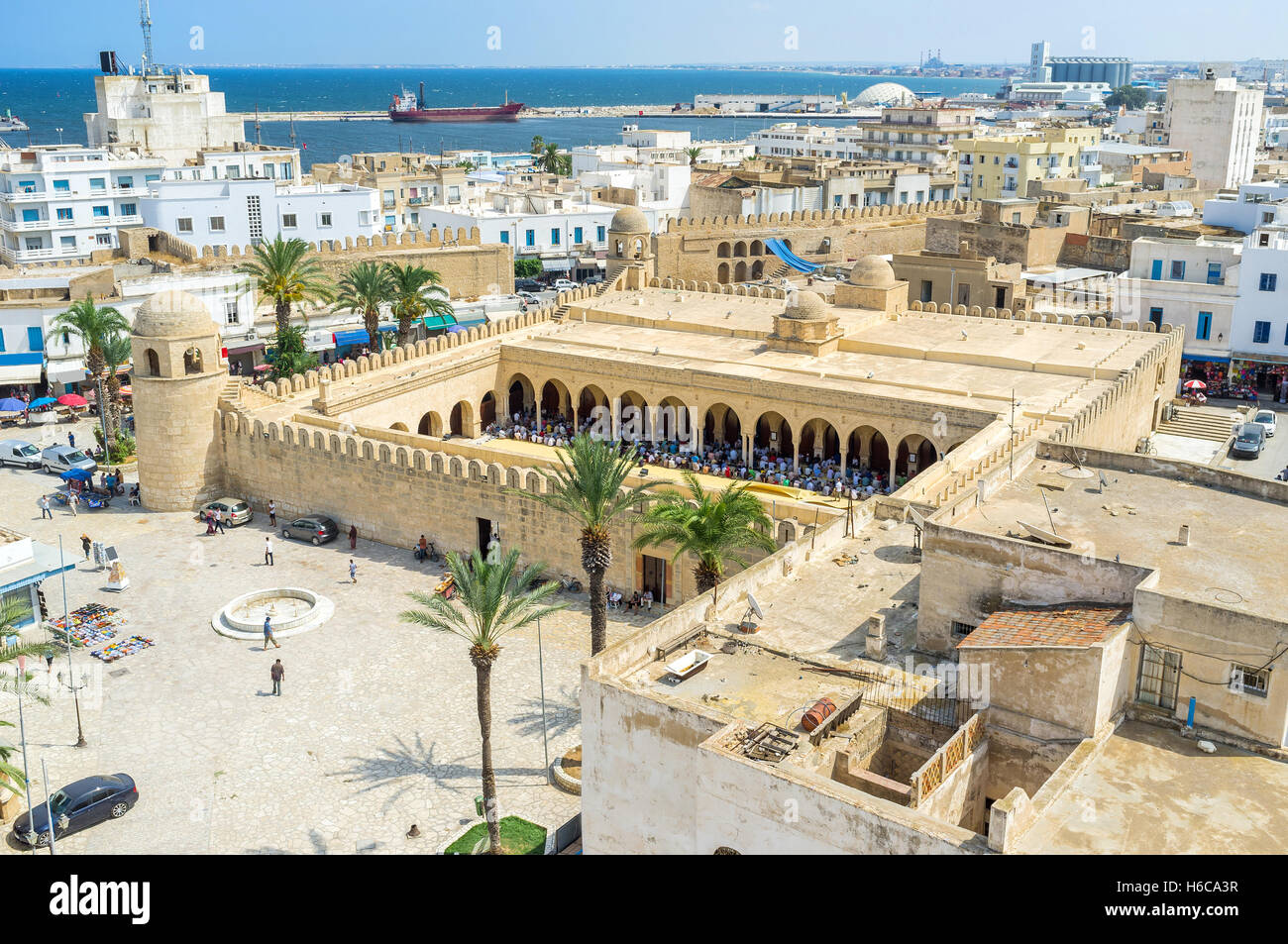 The aerial view of the Place des Martires with the numerous muslims in Grand Mosque during Mohammedan prayer, Sousse, Stock Photo