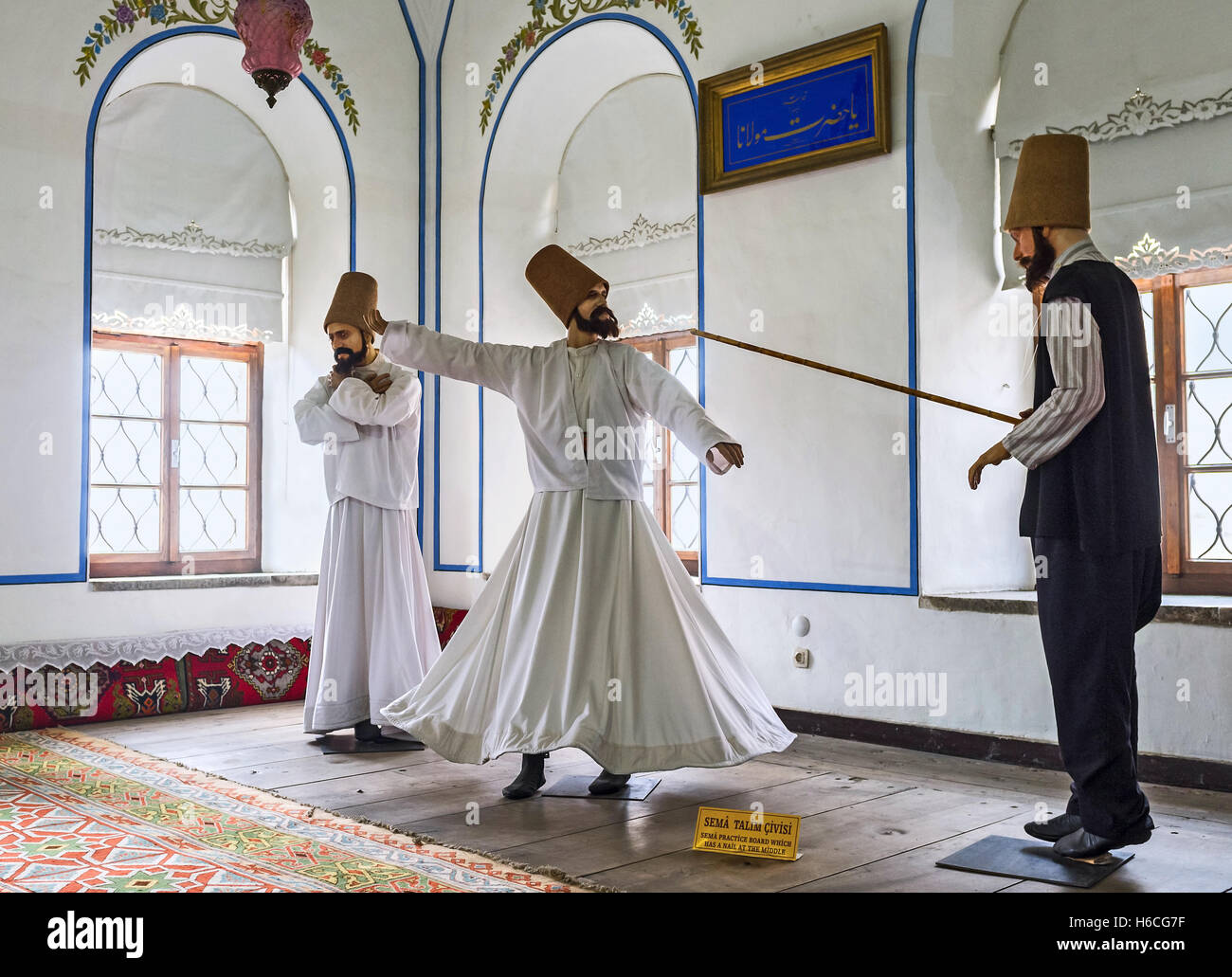 The mannequins of dervishes in Mevlana Museum depict the ceremony of ritual dervish whirling dance, an active meditation - Stock Image