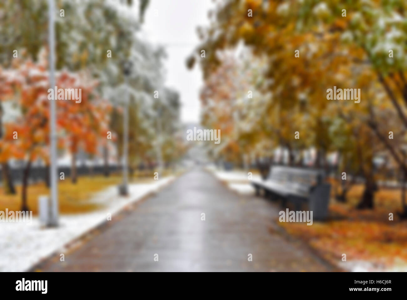 City alley with the first snow - blurred image - Stock Image